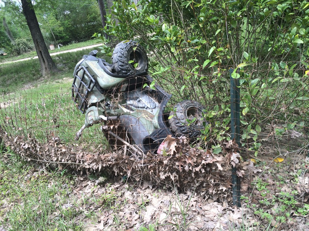 ATV Washed Up on a Fence in Texas