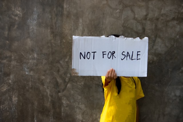 Girl Holding Not For Sale Sign